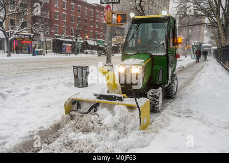 New York, NY 4 January 2018 - A Parks Department truck clears the snow on Sixth Avenue during the post CHristmas - Stock Image