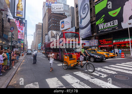 View of W 49 st from a zabra crossing and a sightseeing bus and a orange  cycle rickshaw, Manhattan, New York, USA - Stock Image