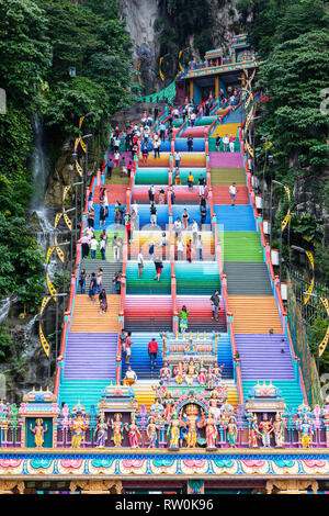 Batu Caves, 272 Multicolored Stairs Leading to the Top, Hindu Deities in foreground.  Selangor, Malaysia. - Stock Image