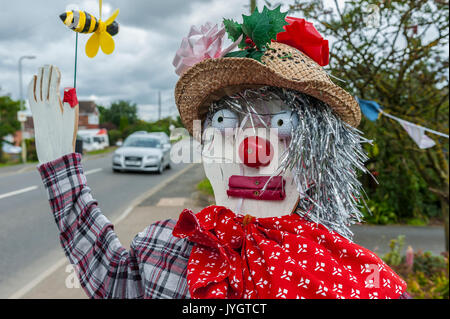 North Kyme, Sleaford, Lincolnshire, UK.  19th August 2017.    Traffic driving through North Kyme greeted by the annual village scarecrow competition.  The competition which is part of the North Kyme Village Show attracts a number of entries which raises fund for various village charities.    Credit:  Matt Limb OBE/Alamy Live News - Stock Image