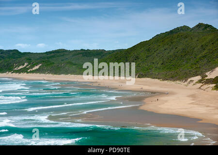People walking on the beach at Brenton on Sea in South Africa. - Stock Image