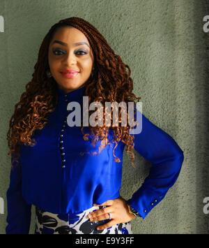 Female model stand akimbo - Stock Image