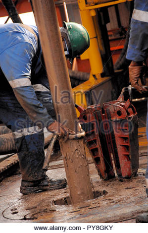Worker with dirty pipe - Stock Image