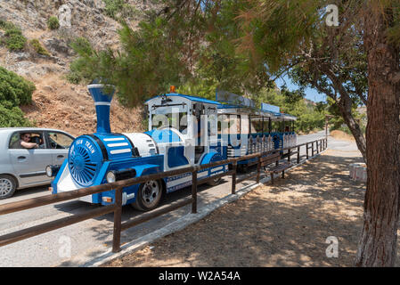 Crete, Greece. June 2019. A tourist road train on a route passing through Plaka a seaside resort in the Lassithi region of Crete. - Stock Image