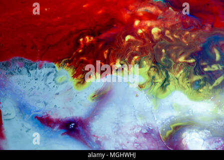 Abstract liquid milk flowing pattern like nebulae in the universe with different colours of white, blue, red and pink. Copy space area for space explo - Stock Image