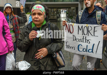London, UK. 17th October 2018. A woman who worked in the nursery at Grenfell speaks at the protest outside the Ministry of Housing, Communities and Local Government by residents living in tower blocks covered in Grenfell-style cladding, Fuel Poverty Action, and Grenfell campaigners demanding that the government make all tower-block homes safe and warm. Credit: Peter Marshall/Alamy Live News - Stock Image