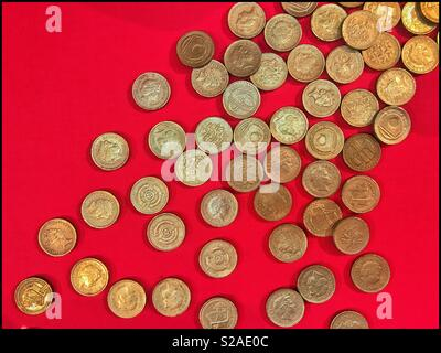 A selection of fake One Pound Coins (£1). These counterfeits make up a display which the general public can visit. Some coins are almost lifelike, others are very poor replicas. Photo © COLIN HOSKINS. - Stock Image