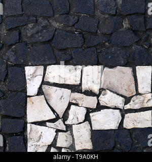 Abstract black & white surface of an outdoor floor. Beautiful, harmonic and simple details of architecture. The floor is made of small pieces of rocks - Stock Image