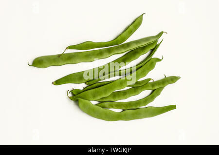 Lanceolate immature tender green bean pods used for eating on white background - Stock Image