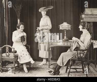 Young women knitting at home - Stock Image