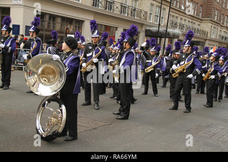 London, UK. 1st January, 2019. About 8,000 performers representing the London boroughs and over 20 countries from across the globe take part on the annual New Years Parade on the street of London on January 1, 2019. The parade will as is custom include dancers, acrobats, cheerleaders, marching bands, historic vehicles and huge balloons making their way from Green Park Tube station to Parliament Square. Credit: david mbiyu/Alamy Live News - Stock Image