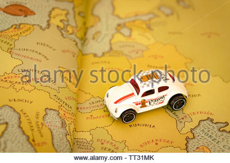 Classic Mattel Hot Wheels Volkswagen Beetle sport toy car on a European map from a atlas book on circa June 2019 in Poznan, Poland. - Stock Image