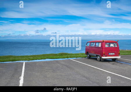 Red camper van parked at Duncansby Head in Sutherland, Scotland, UK - Stock Image