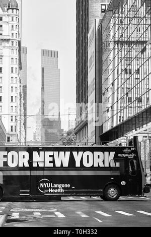 New York, USA - July 01, 2018: Sightseeing bus with For New York sign on a street of Manhattan. - Stock Image