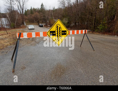 Quebec,Canada. Spring flooding forces the closure of St-Patrick street in Rawdon - Stock Image