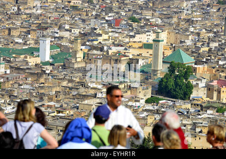 Fez, Fes, Morocco, North Africa. Tourists with Moroccan guide looking down on Fez, Morocco, North Africa. - Stock Image