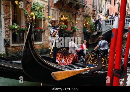 Family gondola ride, Venice, Italy - Stock Image