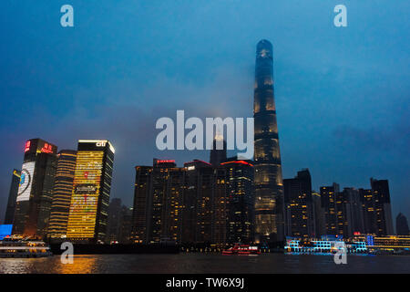Night view of Pudong skyline by Huangpu River dominated by Shanghai Tower, Shanghai, China - Stock Image