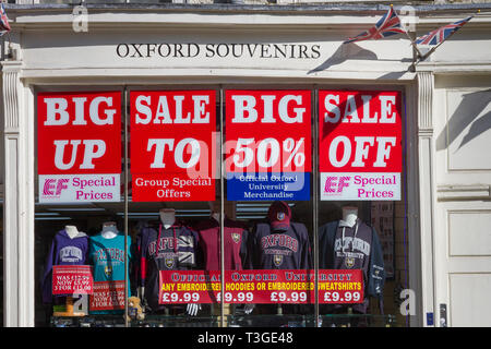 Bright Sale signs in the window of the shop Oxford Souvenirs - Stock Image