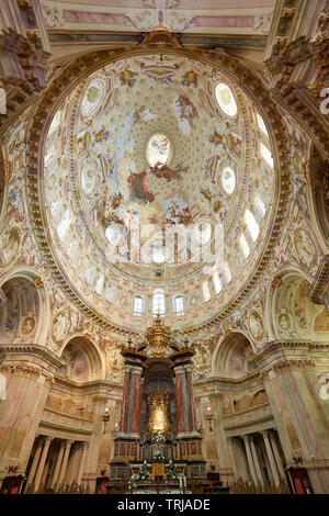 Vicoforte, Italy - August 17, 2016: Sanctuary of Vicoforte elliptical baroque dome with frescos and Holy Mary ancient painting in Piedmont, Italy - Stock Image