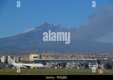 Catania, Sicily, Italy. 24th December, 2018. Europe's most active volcano, Mount Etna, in eruption in the background of Catania airport. were disrupted. Credit: jbdodane/Alamy Live News - Stock Image