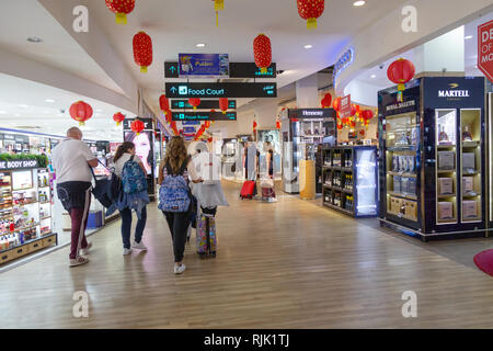 Velana International Airport, male the Maldives Asia - passengers in the departure lounge and duty free shops - Stock Image