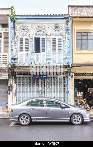 Phuket, Thailand - 11th April 2017: Unrestored Sino Portuguese architecture. Many buildings in the city have been restored. - Stock Image