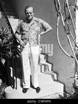 Randolph Churchill smoking a cigarette in Palm Beach, Florida, ca 1950 - Stock Image