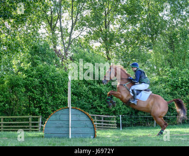 Rockingham Castle grounds, Corby, England. Saturday 20th May 2017. Sam Gillespie and his horse Fernhill leap an - Stock Image