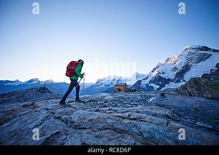 Hiker on rocky surface, Mont Cervin, Matterhorn, Valais, Switzerland - Stock Image