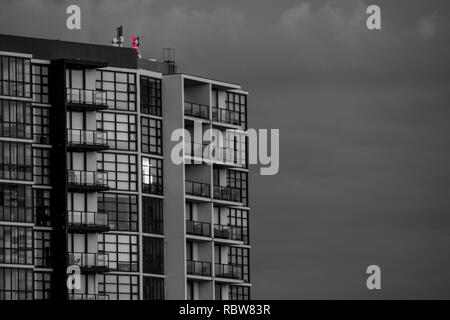 modern apartment building in front of cloud - Stock Image