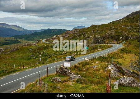 Molls Gap on the Ring of Kerry route in County Kerry, Ireland is a gap in the barren landscape where the road drops through to Kenmare. - Stock Image