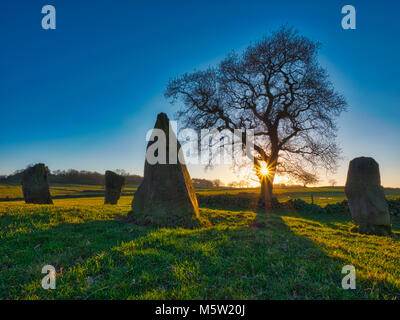 spectacular sunset on a bitterly cold day at The Grey Ladies / Nine Stone Close Stone Circle, Robin Hood's Stride - Stock Image