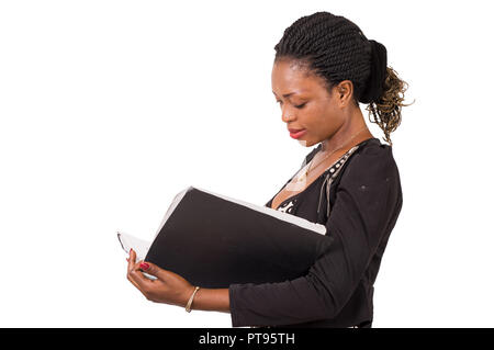 Portrait of young businesswoman standing reading a document isolated on white background - Stock Image