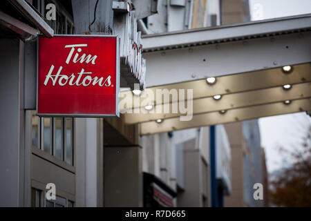 MONTREAL, CANADA - NOVEMBER 5, 2018: Tim Hortons logo in front of one of their restaurants in Montreal, Quebec. Tim Hortons is a cafe and fastfood can - Stock Image