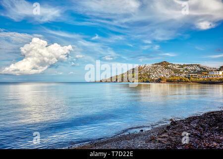 Cukurbuk bay and the sea, beach, mountain and settlements in Bodrum, Gumusluk, Mugla, Turkey. - Stock Image