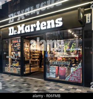 Exterior, entrance and window display of the Dr Martens shop (shoe chain branch) in central Glasgow, Scotland, UK - Stock Image