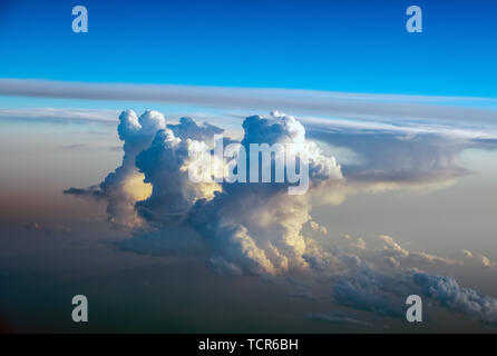 Dramatic Cumulonimbus cloud formations at sunset taken from an aircraft window over southern europe. - Stock Image