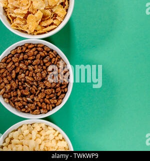 Bowl of Rice Krispies Frosties and Coco Pops Breakfast Cereals Shot From Above With No People - Stock Image