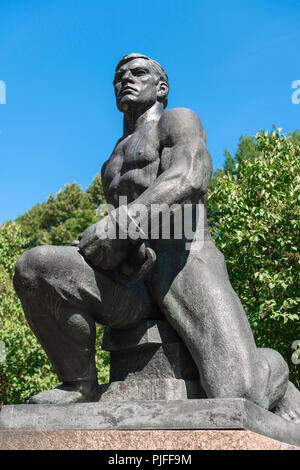 Communist monument, view of a Communist era statue of a powerful young nordic man in the Tallinn City Park and Gardens, Estonia. - Stock Image