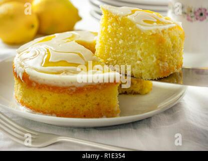 Light lemon drizzle Victoria sponge layer cake slice - Stock Image