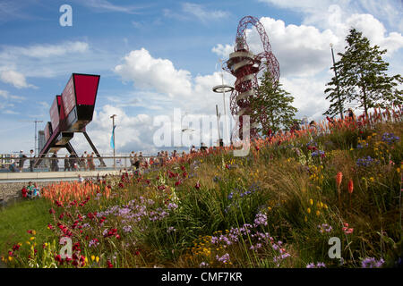 Stratford Gate, Orbit and flowers at Olympic Park, London 2012 Olympic Games site, Stratford London E20 UK, - Stock Image