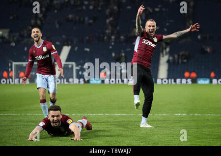 Aston Villa's Glenn Whelan, John McGinn and Conor Hourihane celebrate victory during the Sky Bet Championship, Play-Off, Second Leg match at The Hawthorns, West Bromwich. - Stock Image