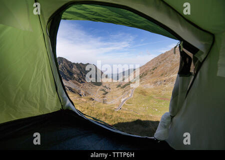 Scenic view of mountains seen through tent - Stock Image