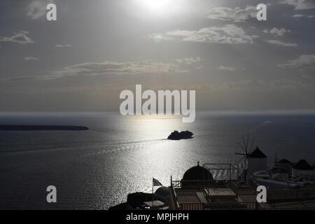 Sunset off Oia on Santorini with cruise ship - Stock Image