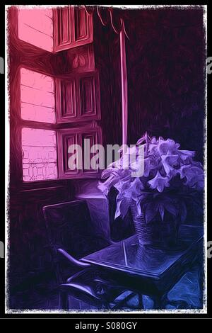 Vase of lilies before a leaded glass window in pink and purple light - Stock Image