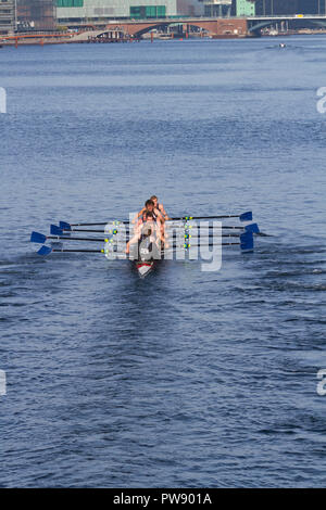Copenhagen, Denmark, 13th October, 2018. A team from Aalborg University Rowing Club in the eight race in the 6,5 km international regatta, the Copenhagen Harbour Race, from Langebro in the inner harbour to the lock gate system in the South Harbour and back. Langebro Bridge and finish line within sight. - Stock Image
