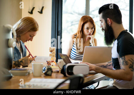 Group working together in shared office space - Stock Image