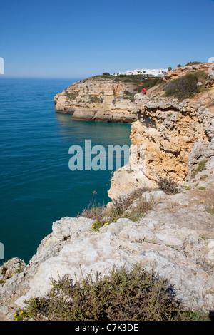 Portugal, Algarve, Benagil, View over Rocks & Village, Fishing - Stock Image