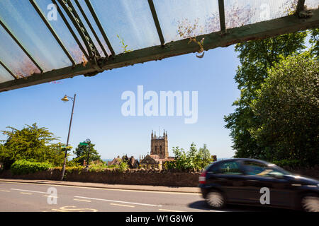 A view of Malvern Priory from the Bus Shelter below the Rose Garden in Great Malvern, Worcestershire, England - Stock Image